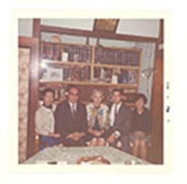Group portrait of Alice Cowdry and four unidentified men and women in the Liang home, Taipei, Tai...