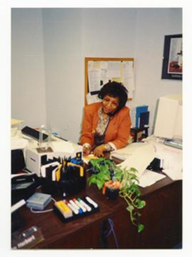 Portrait of Virginia Nelson at her desk, Barnes Hospital Department of Social Work.