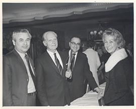 Group portrait of Carl F. Cori and Anne Cori with two unidentified men at the end of the banquet ...
