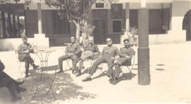 Seated officers in front of the Annex Officers' Mess, Bou Hanifia, Algeria.