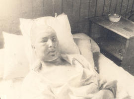 Sergeant H.E. Bowen in a hospital bed.