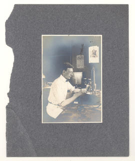 Man using lab equipment.