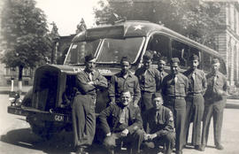 Group portrait of soldiers posing with the first captured and rehabilitated German bus to arrive ...