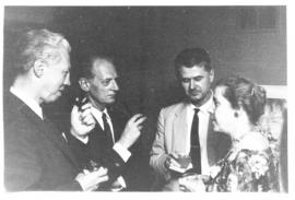 Carl V. Moore, Carl F. Cori, Oliver H. Lowry, and Helen B. Burch at a party.