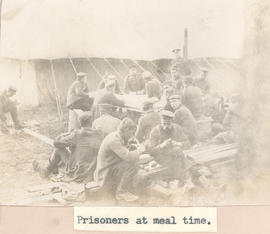 Prisoners at meal time.