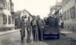 "Group portrait of four enlisted men assigned to General Hospital 21 ""liberating furniture. &..."