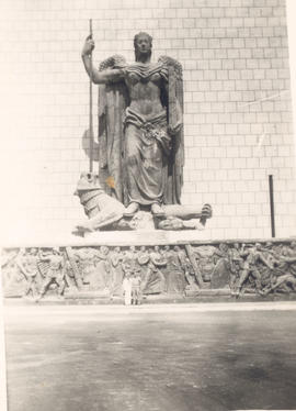 Two unidentified men posing with the statuary at 23rd General Hospital, Naples Medical Center.