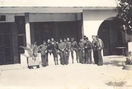 Group portrait of officers in front of the Annex Officers' Mess, Bou Hanifia, Algeria.
