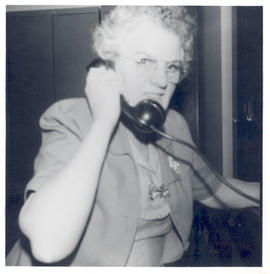 Woman talking on the phone.