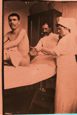 Patient undergoing a procedure on a bed.