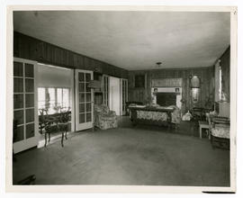 View of the parlor and dining room in the home of Vilray P. Blair.