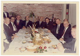 Arthur Kornberg, Robert J. Glaser, and a group of unidentified men at a dinner party.