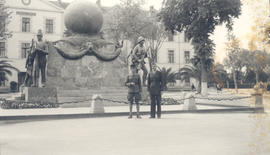 Benjamin H. Charles and an unidentified man posed in front of a French Foreign Legion Monument, S...