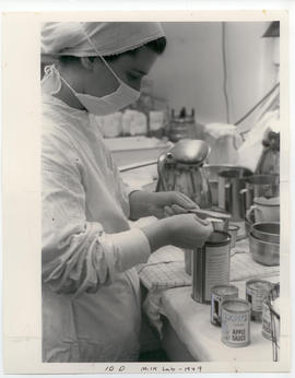 Woman at work in the St. Louis Children's Hospital milk lab.