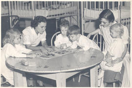 Nurses assisting patients in playing a game, St. Louis Children's Hospital.