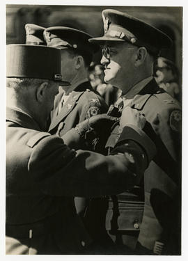 Col. Lee D. Cady receiving a Croix de Guerre with palm from Major General Koenig.