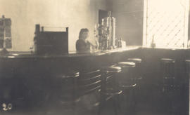 Unidentified woman behind Le Bar Americain at Les Thermes, Bou Hanifia, Algeria.