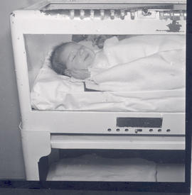 Infant in an incubator, St. Louis Children's Hospital.