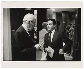 Harold E. Thayer, chairman of the Barnes board of directors, conversing with Samuel B. Guze, vice...