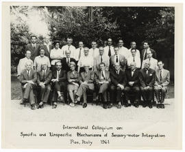 Group portrait of men and women at the International Colloquium on Specific and Unspecific Mechan...