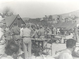 Col. Lee D. Cady at a Meschoui Feast, General Hospital 21, Bou Hanifia, Algeria.