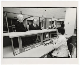 Harold E. Thayer and Robert E. Frank on a tour of the 2300 intensive care unit.