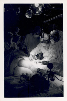View of a surgeon performing an operation on a patient's leg.