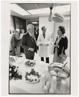 Dr. Leonard Jarett, director of laboratories, speaking with Mr. and Mrs. Ray Rowland.