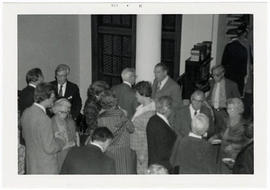 Men and women mingling at a reception at a St. Louis Medical Society reception honoring the Baumg...