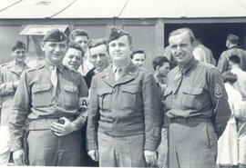 1st Lt. Allan Katz, Maj. William J. Dann, Jr., and T/3 Martin J. Ferguson.