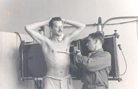 50,000th X-ray examination taken of T/3 Harold E. Hanson, Ravenel Hospital, France.