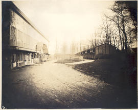 Exterior view of the back of the grandstand and nurses quarters, Base Hospital 21.