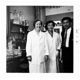 Group portrait of Helen B. Burch, Anne Marie Combs, and Dr. Domrong in the laboratory.