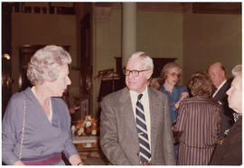 Benjamin H. Charles talking with two unidentified women at a St. Louis Medical Society reception ...