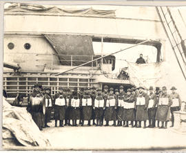 Group portrait of officers wearing life jackets on board the S.S. St. Paul.