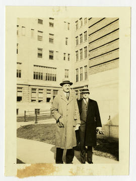 Barney Brooks and Evarts A. Graham posed in front of the Rand-Johnson Building, Barnes Hospital.