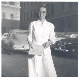 Elizabeth O'Connell, Superintendent of Nurses for St. Louis Children's Hospital, standing in park...