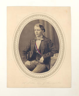 A. Bathe, a friend or fraternity brother of Gustav Baumgarten, in formal attire seated for portrait.