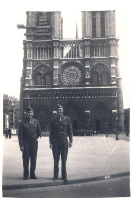Benjamin H. Charles and Lester H. Jasper standing in front of Notre Dame Cathedral, Paris, France.