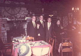 Group portrait of Al Reiser, Charlie Koch, Archev Nushan, and Mrs. Ritchey at a Base Hospital 21 ...