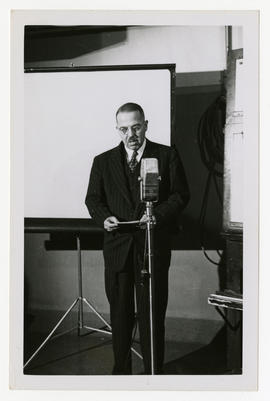 Robert A. Moore speaking at a standing microphone.