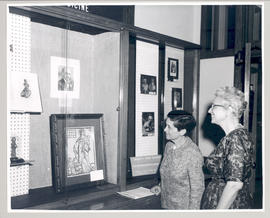 Ruth Silberberg and Estelle Brodman examining the Martin Silberberg Memorial Fund Exhibit, Washin...