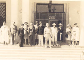 Group portrait of Caid El Mascri ben Moussa with a group at the Grand Hotel Entrance, Bou Hanifia...