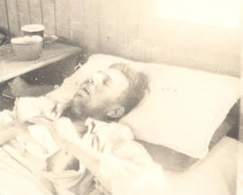 Private W. Remant in a hospital bed.