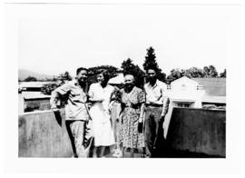 Group portrait of Helen B. Burch and three colleagues outside a laboratory, Orani, Bataan, Philip...
