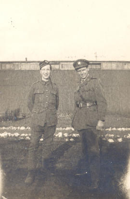 Two unidentified men in uniform.