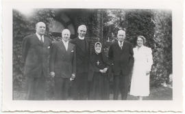 Group portrait of two unidentified men, Father Thomas Knapp, Lucille Finette Papin, Vilray P. Bla...