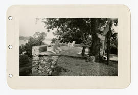 Exterior view of the stone terrace at the home of Vilray P. Blair.