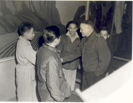 Major General Arthur R. Wilson speaking with Japanese-American patients of the 21st General Hospi...