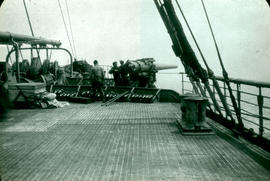 Soldiers loading a mounted cannon on the S.S. St. Paul.
